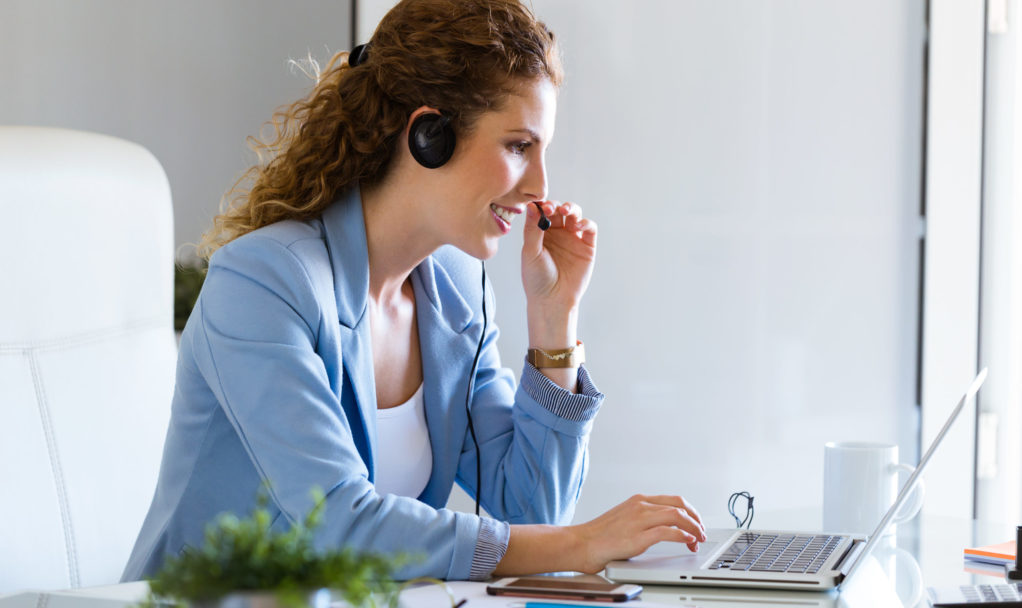 Customer service operator talking on phone in the office.